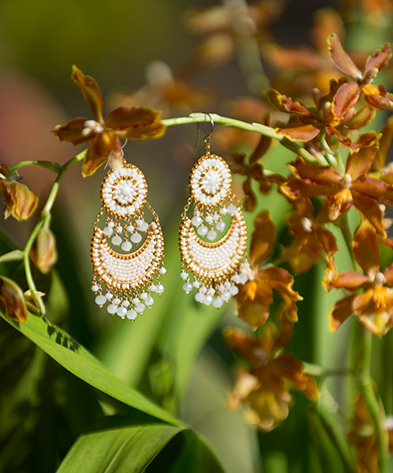 White Miguel Ases chandelier earrings
