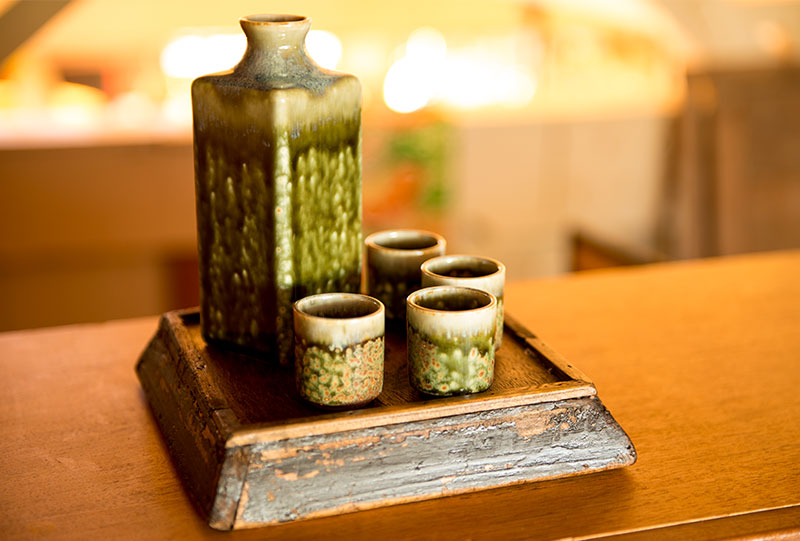Green glaze sake set by Miya.