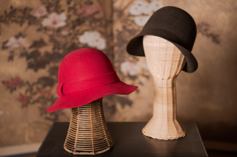 Red and dark brown hat by Asian Eye.