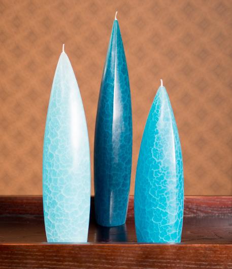 Aqua colored trio of candles.
