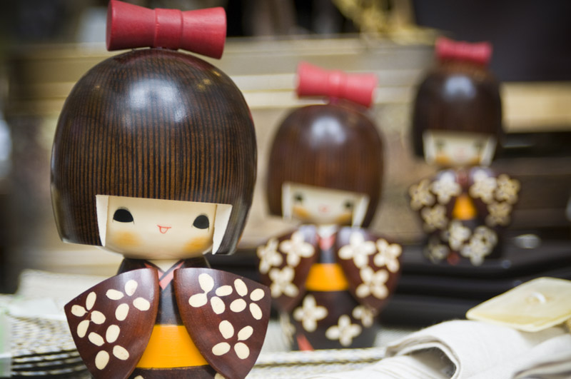 Close up photo of Kokeshi Dolls