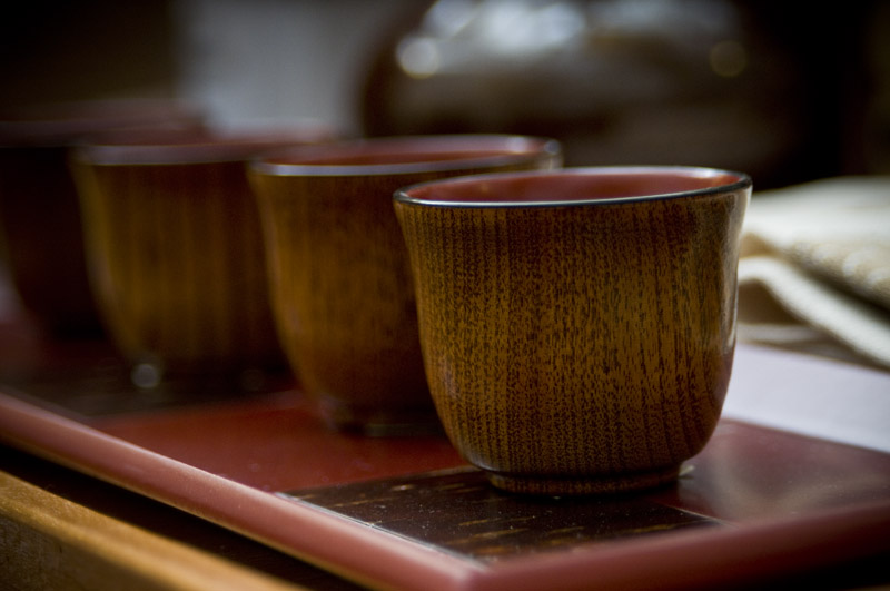 Detail of wooden cups on tray.