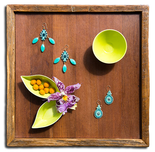 Tray with two pair of Miguel Ases earrings.