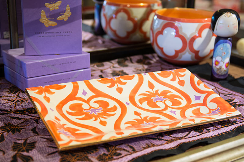 Orange and purple patterned ceramic platter by Jill Rosenwald