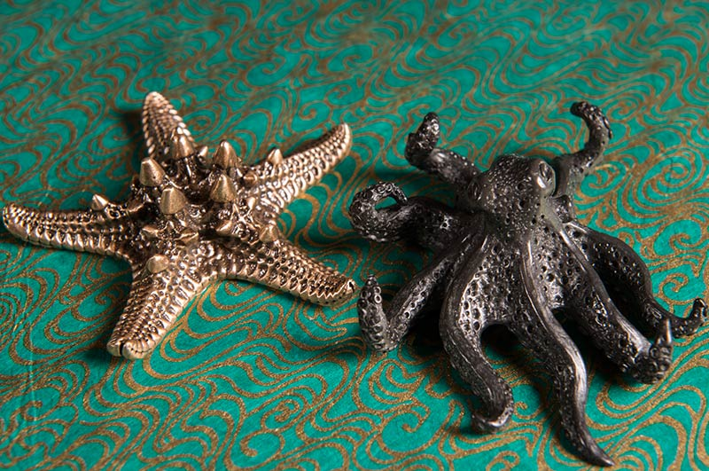 Pewter cast objects of an octopus and starfish